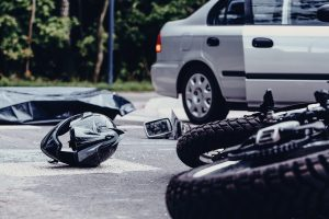 Motorcycle on the side of the road after a fatal accident.